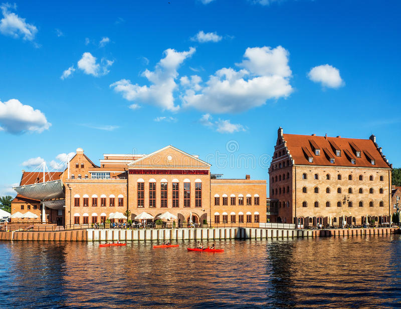 Baltic Philharmonic Hall and old granary in Gdansk, Poland stock photography