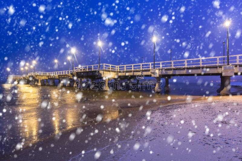 Baltic pier in Gdansk on a cold winter night with falling snow. Poland stock photo