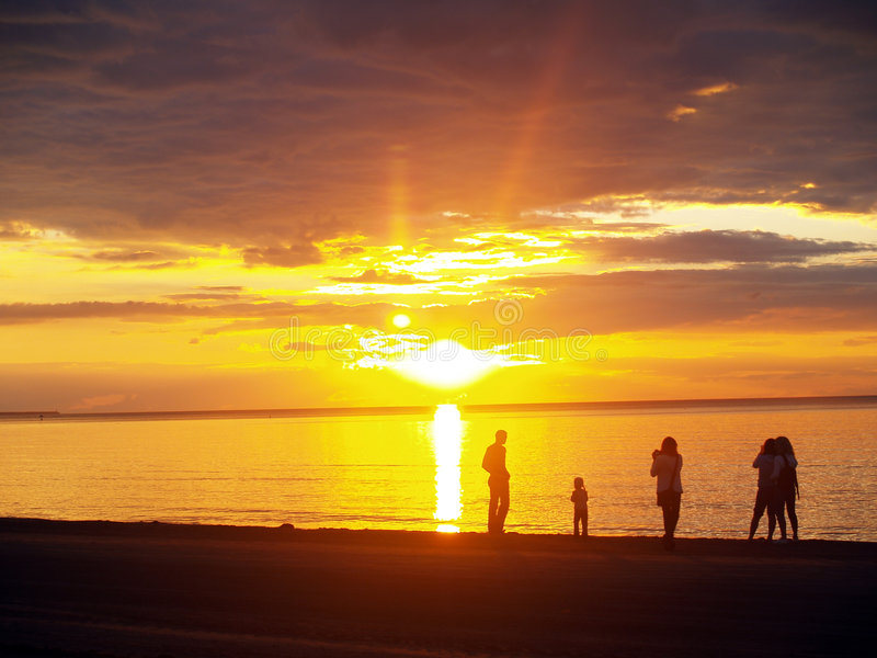 Baltic sea. Loving family looking sunset at the sea stock photography