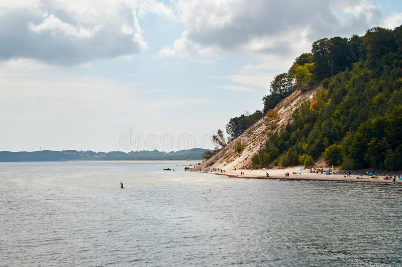 Baltic Sea coast near Sellin on the German island of Ruegen. Baltic Sea coast near Sellin on the German island of Rügen with cloudy skies in summer. Swimmers royalty free stock images