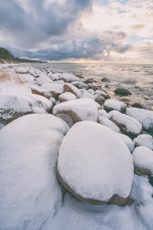 Baltic Sea coast in winter with stones royalty free stock image