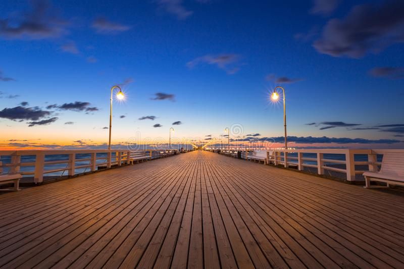 Baltic sea pier in Sopot at sunrise, Poland. Molo, night, travel, lamp, season, beach, tricity, reflection, relax, bay, path, vacation, longest, polish royalty free stock images