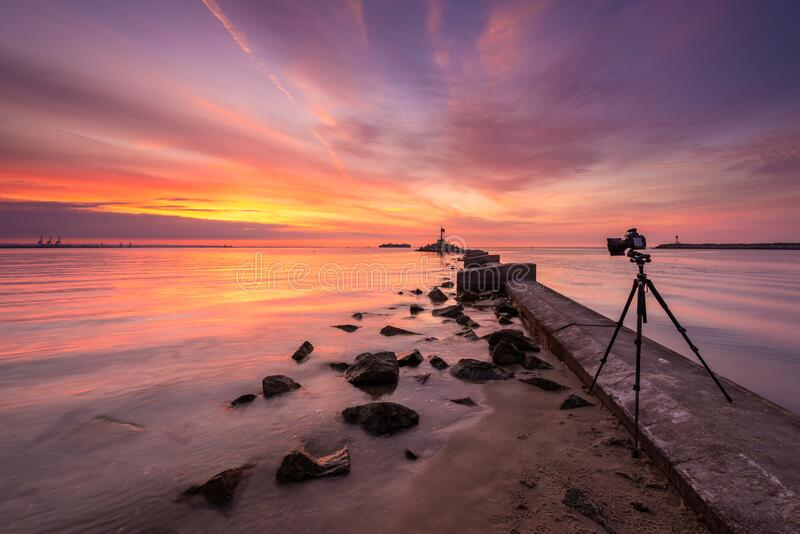 Camera on a tripod with filters for landscape photography. Gdansk, Poland. Baltic Sea during sunset. Camera on a tripod with filters for landscape photography stock photos