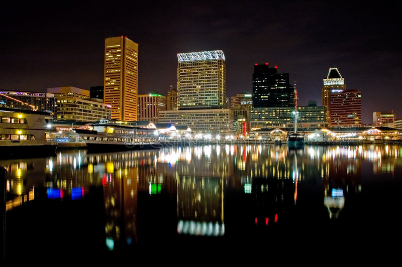 Baltimore Inner Harbor. Night view of Baltimore's Inner Harbor with colorful reflection of lights off the water