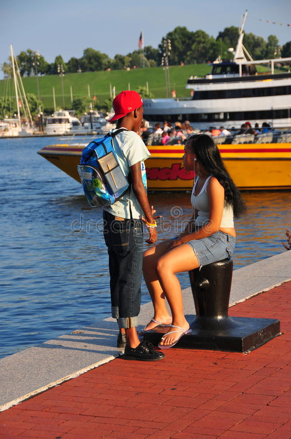 Baltimore, MD: Young Couple At Inner Harbor Editorial Stock Image