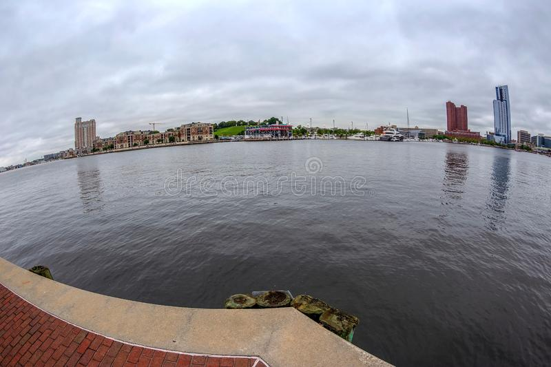 The Waterfront Promenade at the Inner Harbor with large angle view of Potapsco river royalty free stock photo
