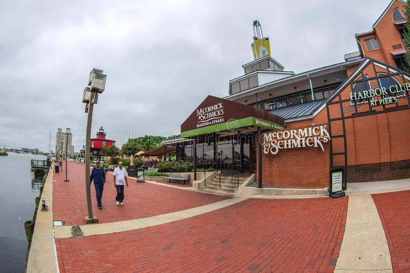 The Waterfront Promenade at the Inner Harbor with the Seven Foot Knoll Lighthouse, first lit stock photos