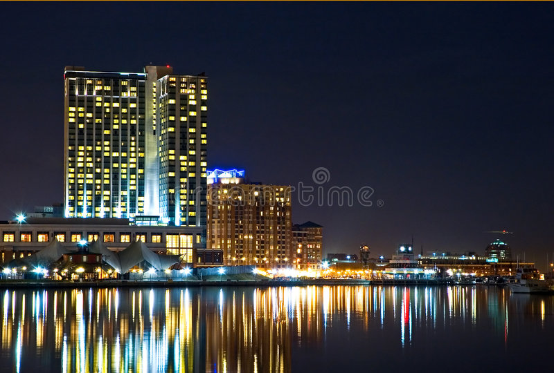 Baltimore Waterfront Condos. High-rise condominiums and hotel on the waterfront at Baltimore's Inner Harbor at night stock photos