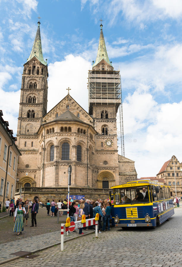 Bamberg, Germany - June 04, 2016: Tourist getting on a sightseeing bus, the Bamberger cathedral on the background royalty free stock photography