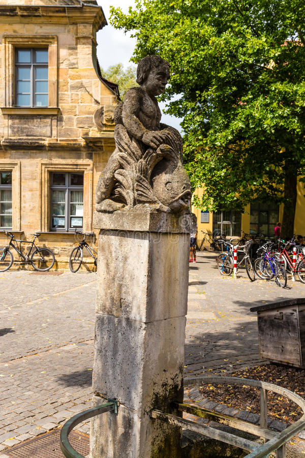 Bamberg, Germany. The old fountain with a statue on the waterfront Am Cranen royalty free stock photo