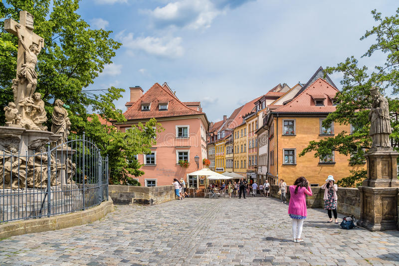 Bamberg, Germany. Sculptures on the Upper Bridge and the beautiful building on the banks of the Regnitz river stock image