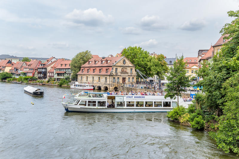 Bamberg, Germany. Tourist boat departs from the pier on the waterfront Am Cranen stock photography