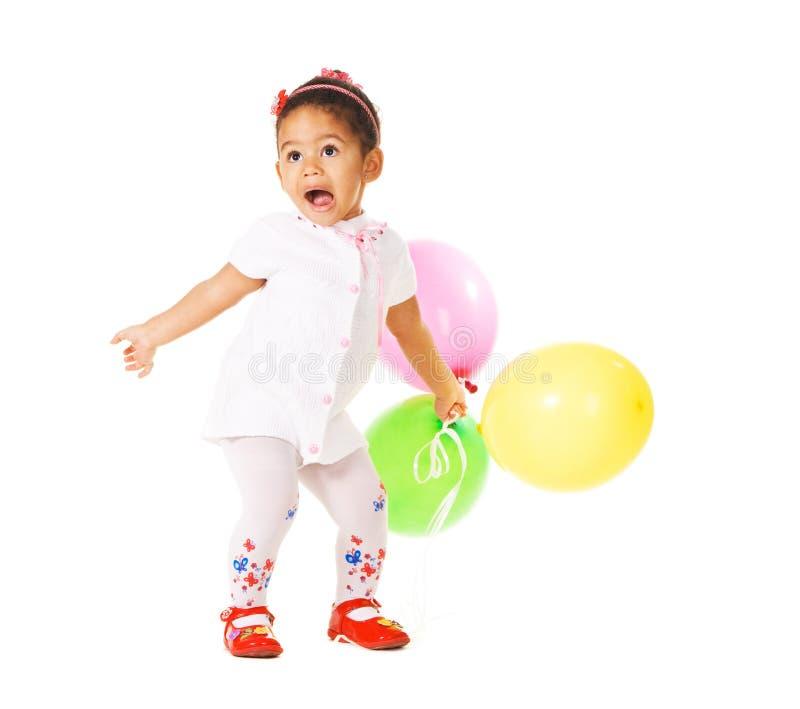 Bambina abbastanza espressiva con gli aerostati fotografia stock libera da diritti