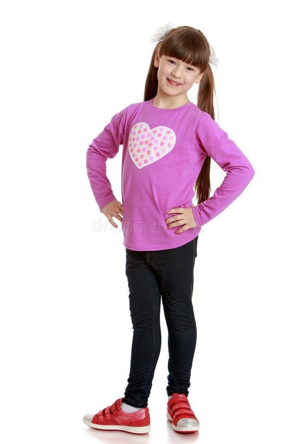 Bambina adorabile con le code lunghe immagine stock