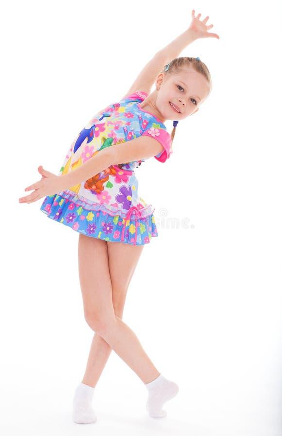 Bambina affascinante in breve vestito. immagini stock