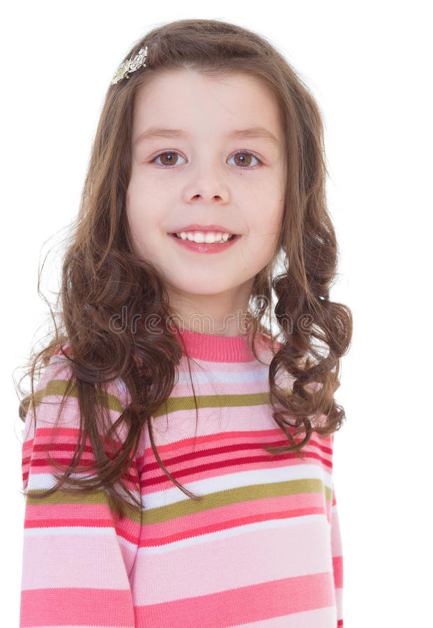 Bambina affascinante in un vestito a strisce rosso. fotografia stock
