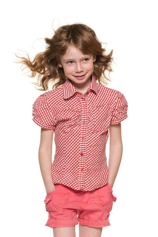 Bambina allegra con capelli scorrenti fotografie stock libere da diritti