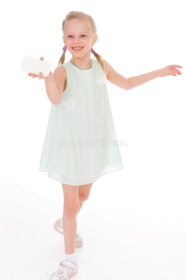 Bambina allegra con lo spazio in bianco bianco fotografia stock libera da diritti