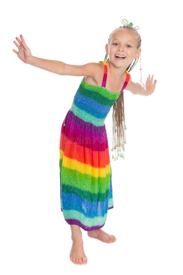 Bambina allegra in un bello vestito fotografia stock libera da diritti
