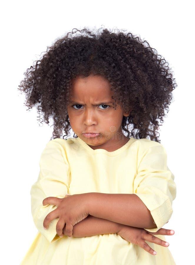 Bambina arrabbiata con la bella acconciatura fotografia stock libera da diritti
