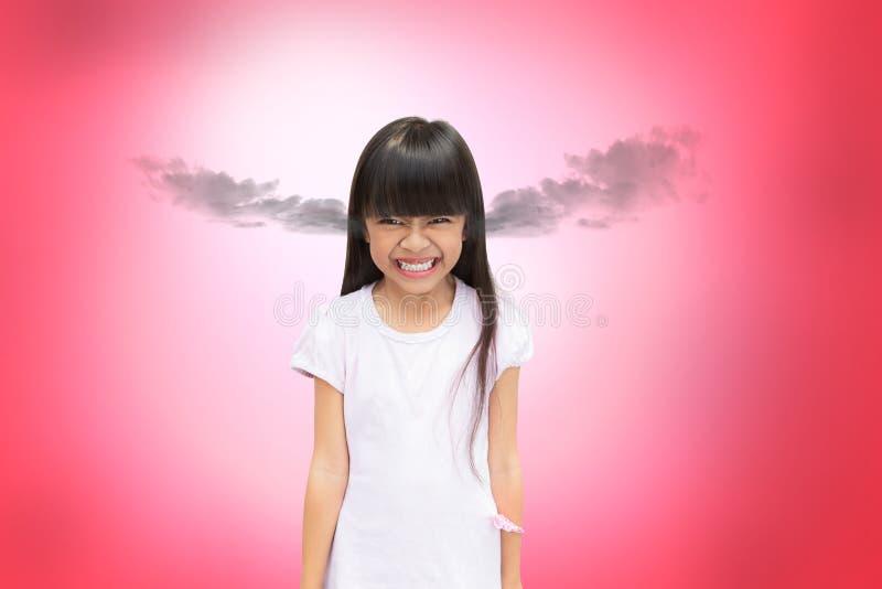 Bambina asiatica arrabbiata fotografia stock