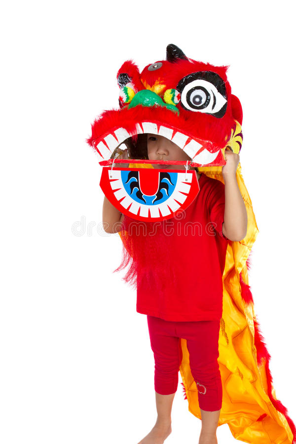 Bambina asiatica in cinese Lion Custome Dance During Chinese N immagini stock