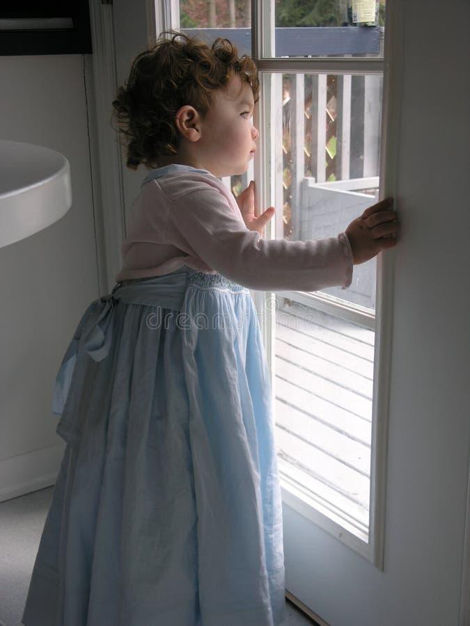 Bambina in azzurro immagine stock