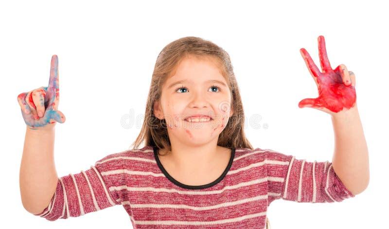 Bambina che gioca con la pittura fotografie stock