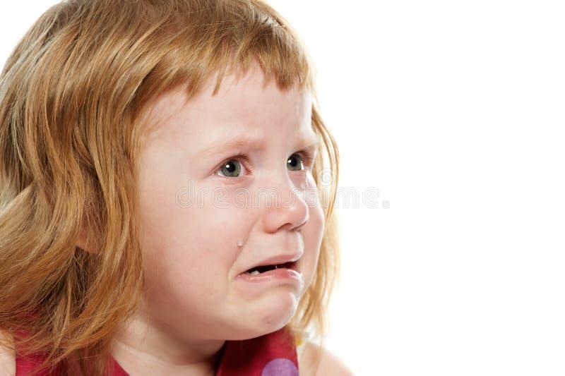 Bambina che grida con gli strappi fotografia stock