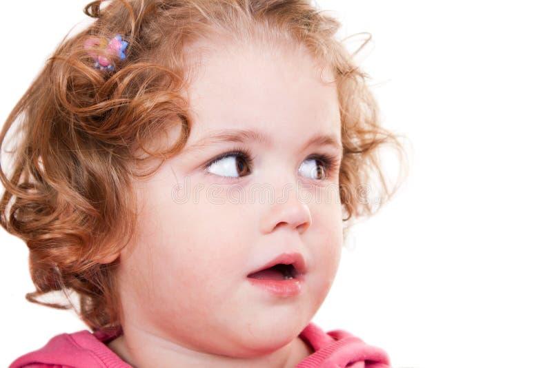Bambina che guarda per parteggiare fotografia stock libera da diritti