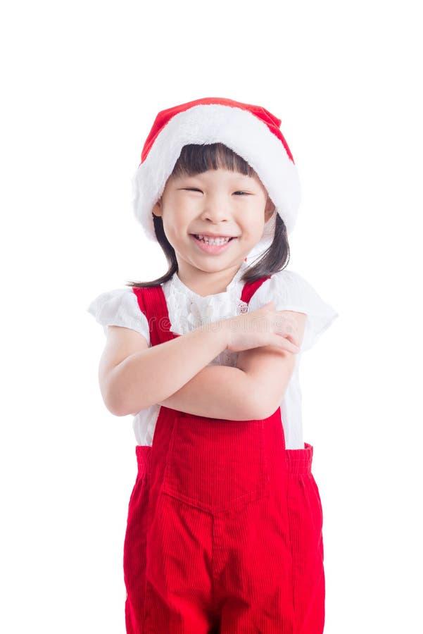 Bambina che indossa sorridere rosso del vestito dal Babbo Natale fotografia stock
