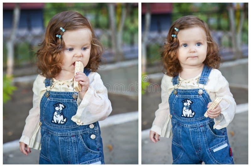 Bambina che mangia cialda immagine stock