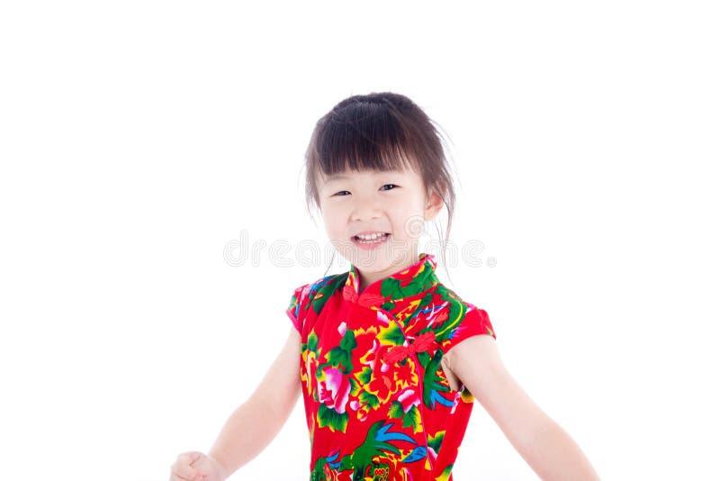 Bambina che sorride sopra il fondo bianco fotografia stock