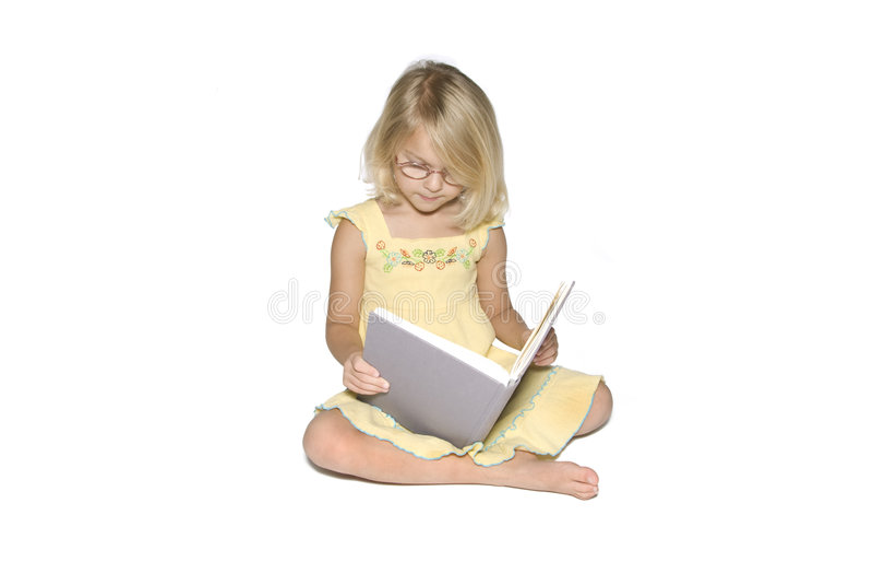 Bambina che studia a destra fotografia stock