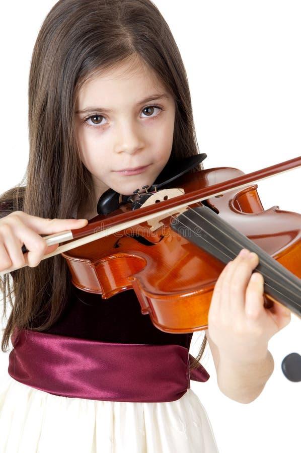 Bambina che suona IL violino stockbilder