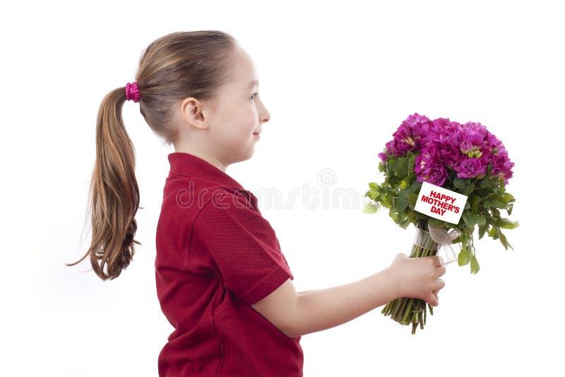 Bambina che tiene un mazzo fotografia stock libera da diritti