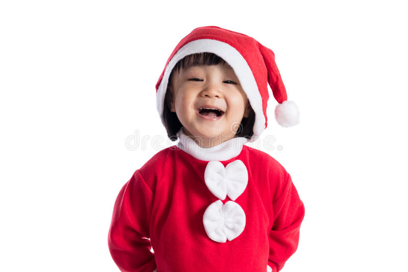 Bambina cinese asiatica felice che porta il costume del Babbo Natale immagini stock libere da diritti