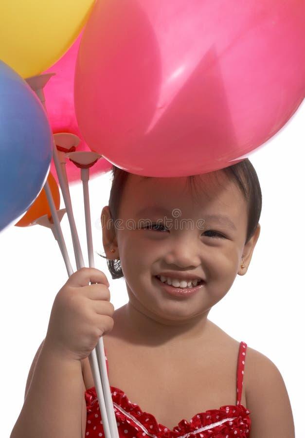 Bambina con gli aerostati fotografia stock