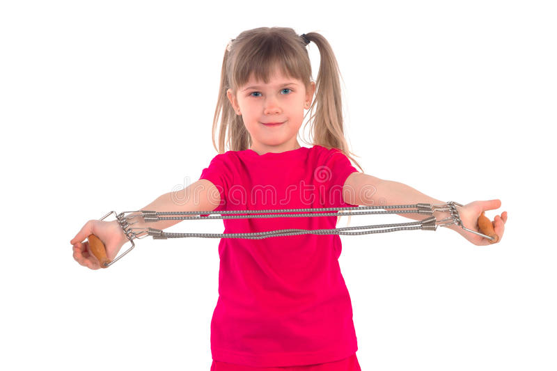 Bambina con gli estensori immagini stock