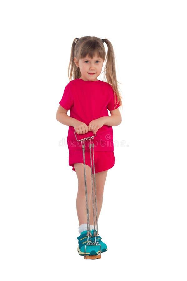 Bambina con gli estensori fotografia stock
