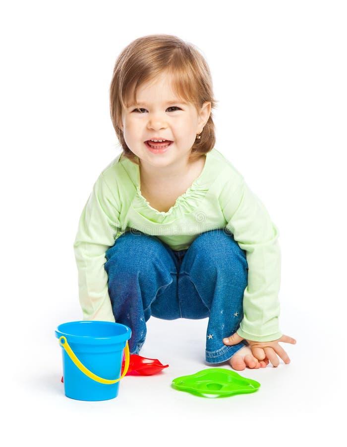 Bambina con i giocattoli immagini stock