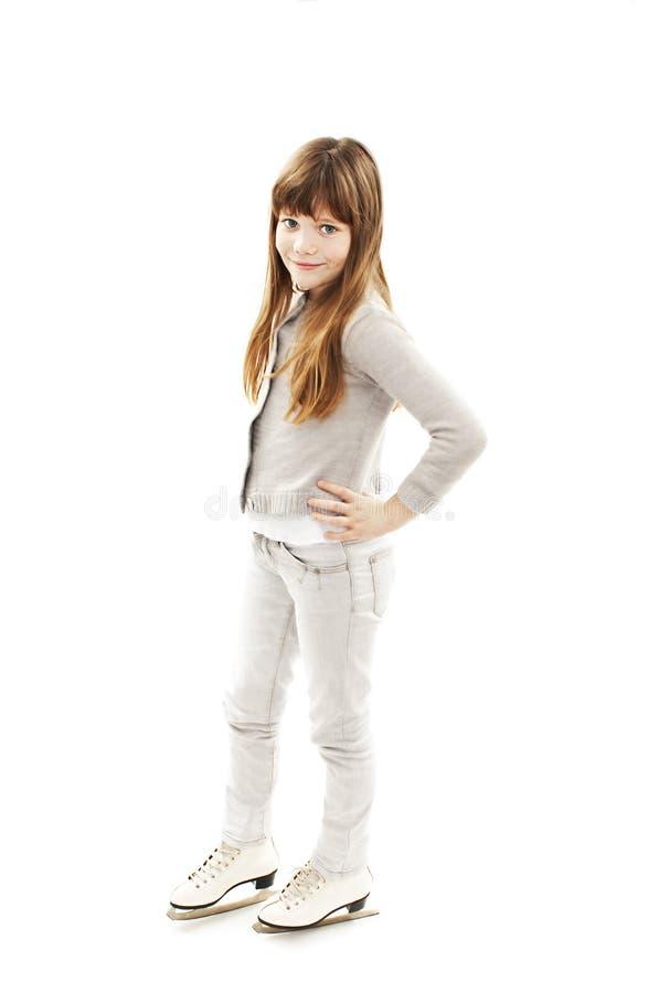 Bambina con i pattini da ghiaccio fotografie stock