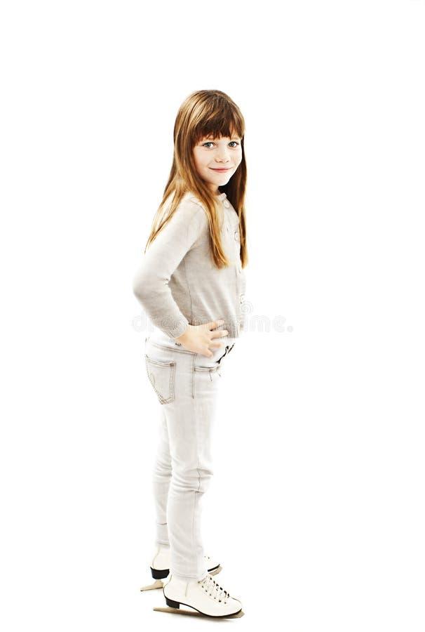 Bambina con i pattini da ghiaccio fotografia stock