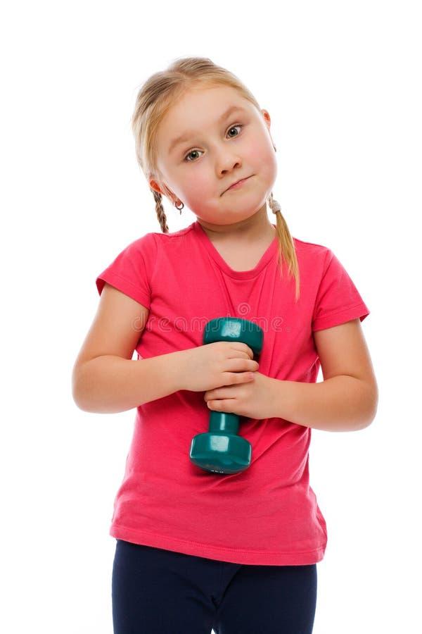 Bambina con il dumbbell. immagine stock libera da diritti