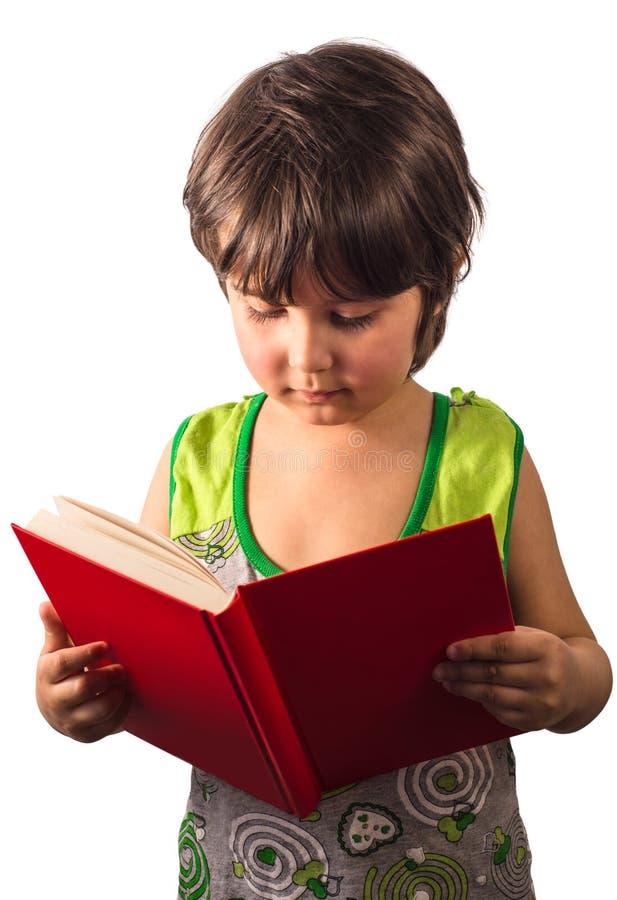 Bambina con il libro rosso isolato su fondo bianco fotografia stock libera da diritti