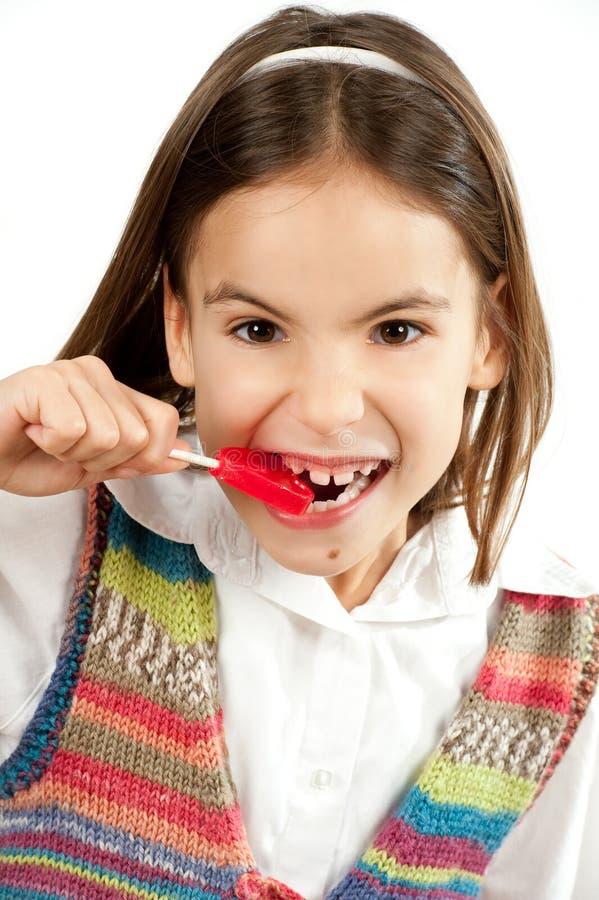 Bambina con il lollipop fotografia stock