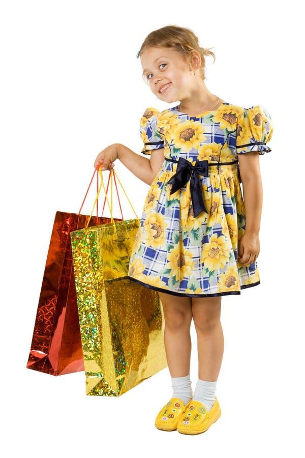Bambina con il sacchetto di acquisto. fotografie stock libere da diritti