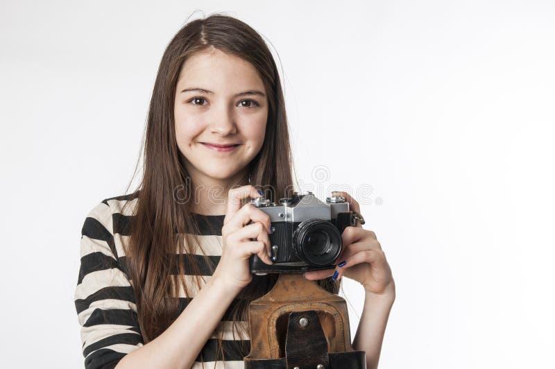 Bambina con il photocamera fotografie stock