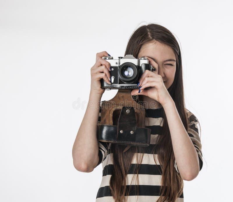 Bambina con il photocamera immagine stock