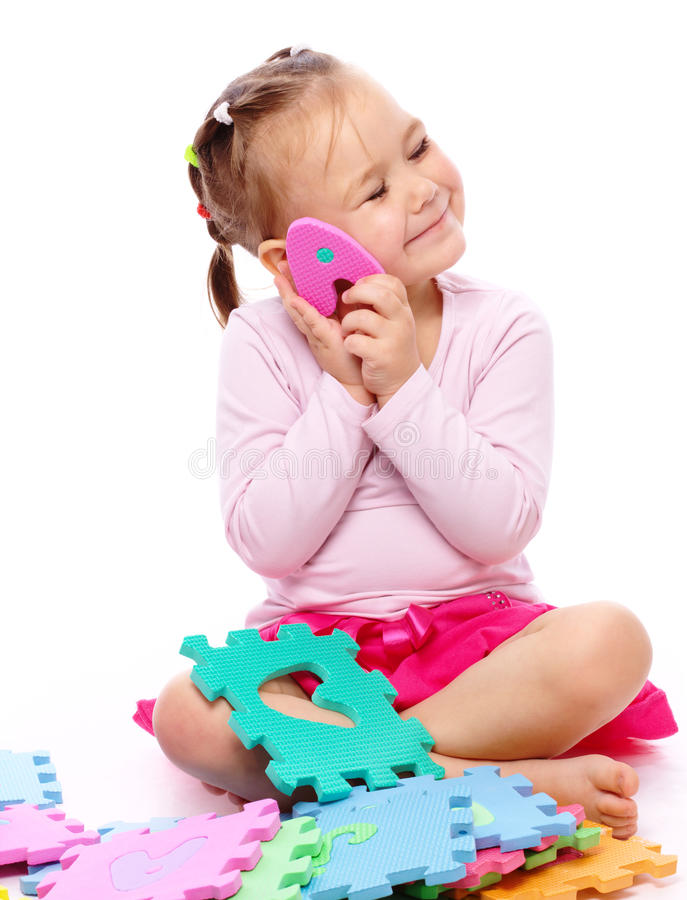 Bambina con l'alfabeto fotografie stock